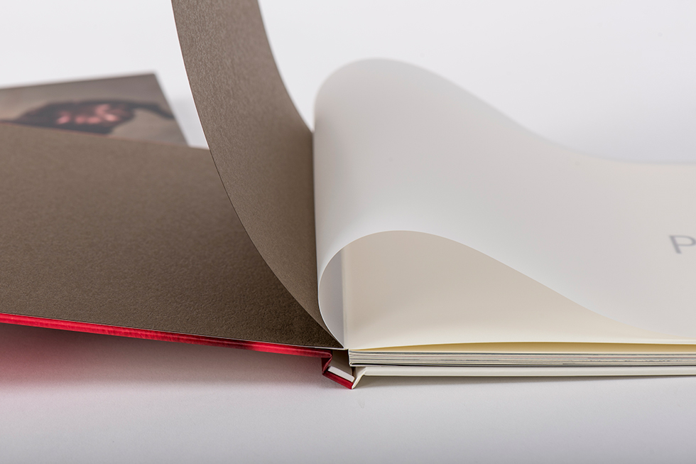 AsukaBook Art Layflat Photo Book Brown inside of front cover, brown paper first page, and vellum sheet