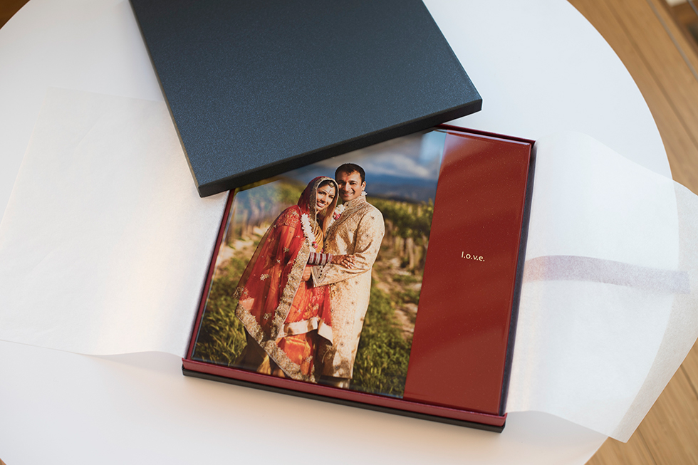 AsukaBook Cosmopolitan Photo Album with red cover shown inside the presentation box