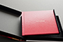 AsukaBook Zen Layflat Impact Photo Book Top view of retro red cover option inside the presentation box